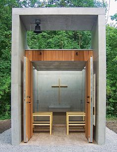 Chapel of St. Benedict, Kolbermoor, Germany A spare cement box with double doors of wood makes up an elegant chapel in Bavaria that was designed by Kunze Seeholzer Architektur & Stadtplanung. Though not a private chapel—it stands within an industrial complex turned park—its size is domestic, barely large enough to seat a dozen people, while its plain materials (cement, wood, metal) echo those of its factory setting. kunze-seeholzer.de