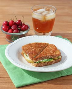 These Grilled Brie and Pear Sandwiches with peppery arugula and a drizzle of sweet honey make a satisfying, easy and healthy lunch or dinner option!  Just 7 Weight Watchers points or 283 calories. www.emilybites.com