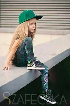 Beautiful little girl with long brown hair loves green
