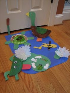 """Pond animals.  Made turtle, duck, life cycle, dragon fly.  Great for pond week.  Ducks were my favorite.  Did not attach to blue """"pond"""" paper."""