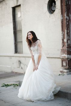 Pretty lace bodice with full tulle skirt.