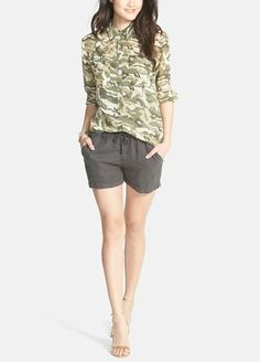Cute summer outfit! Team a printed button-up shirt with a pair of linen shorts.