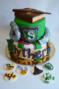 harry potter/slytherin house themed cake and fondant cupcake toppers with rice treat spell book and snake