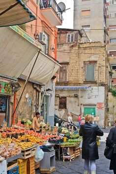 Naples, Italy. Mmmm I smell the fruits, cheeses and flowers of the open market.  Oh and cigarettes for those who've been there. ;)
