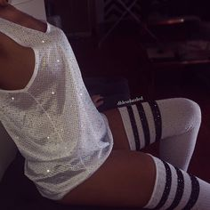 White Crystallized athletic mesh tank. CRYSTAL COLORS: Crystal AB reflects iridescent Crystal Diamond reflects clear Runs large Photographed in Crystal AB Socks sold separately