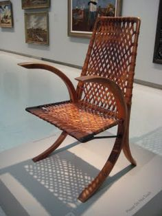 This wood and leather chair from 1939 is by Wharton Esherick.  He used old wagon wheels to create the frame.  An early example of green design.