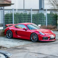 """The new #Porsche #CaymanGT4 in Karmin Red spotted before its debut at the #GenevaMotorShow  Photo by @janb_photography"""