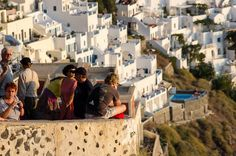 Santorini Overlook (Greece) -- Tourists stop to enjoy the view from a cliffside overlook on the Greek island of Santorini.