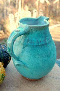 Beautiful as it is functional, this handmade pottery pitcher is in or turquoise glaze. This large one gallon stoneware pottery pitcher in turquoise was wheel thrown. Handmade pottery by J. and Kristen Page in Burnsville North Carolina. Shades Of Turquoise, Turquoise Color, Shades Of Blue, Teal, Ceramic Pottery, Pottery Art, Ceramic Art, Pottery Ideas, Blue Pottery