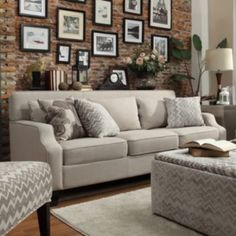 I love the wall with the frames, with the console table in between the couch and the wall. Great idea!