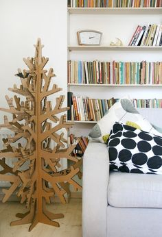 designed-for-life:  This tree is made of 100% natural recycled cardboard. You can easily take it apart in 6 pieces and store it without usin...
