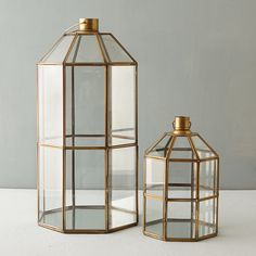 "Stacked windowpanes with brass frames catch the light in this octagonal lantern, with a swing door for the easy addition of candles, string lights, or even a terrarium-style planting.- Glass, brass, foam pad bottom- Wipe clean with soft cloth- Indoor use only- ImportedSmall: 11""H, 7"" diameterLarge: 20""H, 10"" diameter"