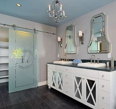 (Photo credit: Kerrie Kelly Design Lab) Love this sliding door- frosted to hide clutter- See roller attachment at base