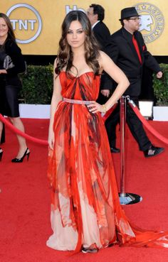 Mila Kunis wearing Alexander McQueen at the 2011 SAG Awards