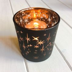 Bronze Stars Votive - Large Cosy down with these gorgeous flickering star votives The clear star shapes in the coating of the glass cast beautiful flickering star patterns around the room once the candle is lit.  Why we love this product:      Casts a dazzling stellar display once lit     They look amazing on their own of as part of a group     Complete with tea-light candle to enjoy straight away!     Also available in a smaller size.  #candles #glass #votives #stars #rustic #home…
