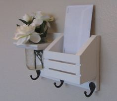 Small entryway organizer. Fresh flowers in the summer, dried flowers for the winter.