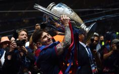 Messi holding trophy