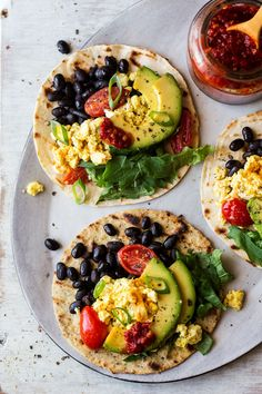 Vegan breakfast tacos with scrambled tofu are delicious, nutritious and easy to make. They make a great plant-based breakfast. Gluten-free option included.