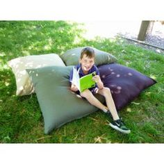 Outdoor Cushion 90cm x 90cm , IDEAL FOR outdoor activities and class, shown with child sitting on cushion