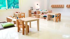 Montessori toddler classroom - look at those coat hooks, even lamps make the space inviting