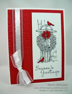 Winter-Memories.  Dawn Olchefske created this striking card using the Winter Memories stamp set from Stampin Up.  I love the simple colors and the small pops of red with the cardinals and bow.