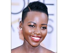 """@Byrdie Beauty - The Golden Globes    """"Modern day Nefertiti,"""" is how Barose describes Nyong'o's show-stopping look at the Golden Globes. Her red Ralph Lauren gown called for """"elongated black liquid liner, a sepia red mouth, and gilded gold eyes,"""" he told us. He used Chanel's Liquid Liner ($34) and Rouge Allure Lipstick ($34) in Pirate, then dabbed the brand's Illusion d'Ombre ($36) in Vision onto the actress' eyes."""