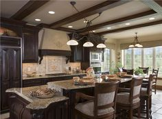 Very nice kitchen! Love the beams!