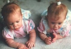 Baby picture of the Olsen twins. I looked JUST like them when I was a baby.