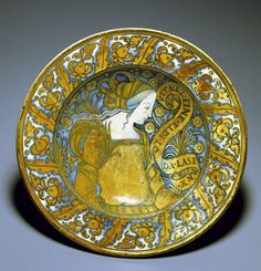 Umbria, Deruta ~ ca.1500-ca.1530 ~ patto da pompa ~ Possibly made by a member of the Masci family of Deruta ~ tin-glazed earthenware ~ Renaissance ~ Large decorative dishes, known as piatti da pompa, were a speciality of sixteenth-century Deruta potters ~ The girl on this dish closely resembles the Eritrean Sibyl in Perugino's fresco of God the Father announcing the Salvation in the Collegio del Cambio, Perugia, the nearest large city to Deruta ~ Fitzwilliam Museum Collections