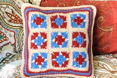 Add a little granny charm to the decor with these pretty pillows ... the FREE crochet pattern features small grannies on one side and a large granny on the other for a fun reversible look ...