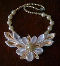 another different way of making a flower from ribbon.                                                                                                                                                      More