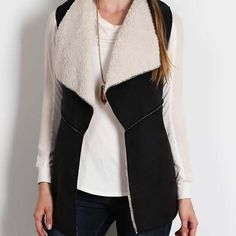 Black Vest S M L This black vest is a combination of faux fur and faux suede. A great addition to your wardrobe! Sizes: S/M and M/L Sweaters