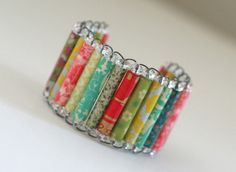 Kind of a cute bracelet made with scrapbook paper; would be a good kids project.