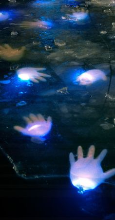 Latex Gloves with Glow Sticks in Your Pond | Click Pic for 27 DIY Halloween Decorating Ideas for Kids | Easy Halloween Party Decor Ideas for Kids