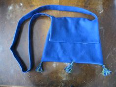 Blue wool medieval pilgrim bag lined in linen with tassles.