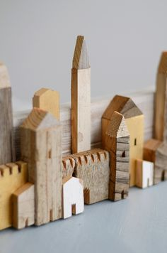 This is more like a little town wall than a group little houses but it looks adorable just the same. Found on s i n n e n r a u s c h. This is what you do with the really small stuff from the bottom of the wood scraps bin. Really like the little details ;)