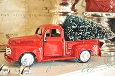Use spray paint to turn a new toy into an old truck - Genius ! I wanted one for my Christmas decorations.  This one was a Harley toy truck painted to look vintage (from Jennifer Rizzo)
