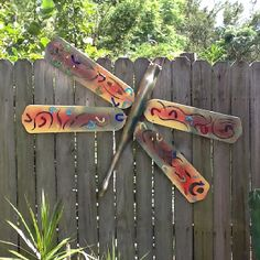 My dads lawn art. Repurposed chair legs and fan blades