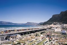 "Muizenberg, Cape Town - the ""other side of the mountain"" for those of us living on the Atlantic side! Namibia, Cape Town South Africa, Live, Continents, Paris Skyline, Travel Destinations, Dolores Park, Surfing, Scenery"