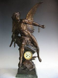 A good antique French clock, circa 1890s. A large winged angel depicted. Dimensions: 33X16X11. Scrpited  La Pensee Pruant an Chaines.