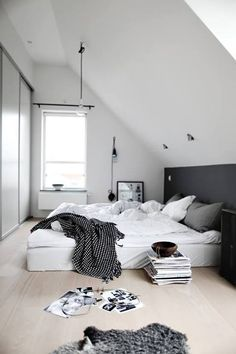 Use box spring but not anything more to raise the bed. Paint while like a headboard to stand out.