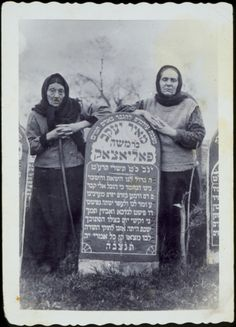 Mrs. Polaczek and her daughter Mariyasl Yurkanski stand by the grave of their husband and father, Meir Yaakov Polaczek. Mrs. Polaczek was murdered by the Germans during the September 1941 mass killing action in Eisiskes. Mariyasl Yurkanski was killed after the war by the Polish Home Army.
