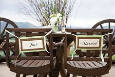 Bride and groom chair signs.