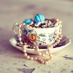 Good way to utilize those tea cups - jewelry holder.