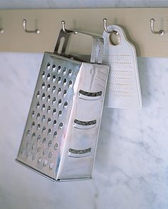 Use your walls as storage space. Install hooks and items like graters can find a permanent home... not very attractive, probably never going to happen here.