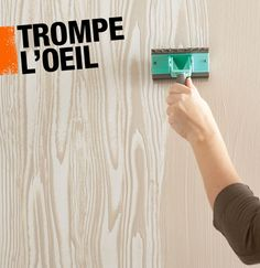 Trompe l'oeil is a painting technique in which paint is used to create an optical illusion. The faux bois technique above uses paint to give walls the look of washed wood.