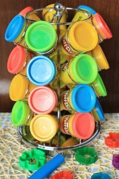 What a clever idea for storing play dough! Keep an eye out for a pod holder at yard sales and discount stores!