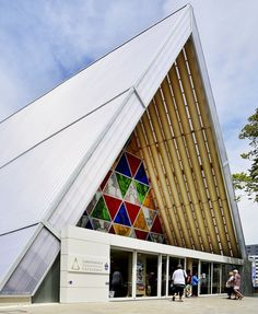 New Zealand's Cardboard Cathedral, built after the 2011 Christchurch earthquake destroyed the city's namesake church, is a temporary A-frame structure made of steel, wood, polycarbonate, and interior beams of cardboard tubes. Its most recognizable feature, however, is the large-scale stained-glass window at its front featuring images from the original cathedral's rose window.