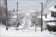 Astoria, Oregon in the snow. There's nothing like a coastal town covered in snow. My aunt lived there and we would drive up to visit her and see the spectacular town of Astoria and it's old Victorian homes and breathtaking sea view