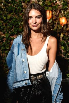 Emily Ratajkowski expertly illustrating the off-the-shoulder denim jacket shrug. Extra style points for the deconstructed/reconstructed jean details